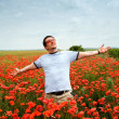 Stock Photo: Young man in a field