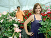 Couple in a greenhouse — Stock Photo