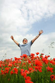 Man in a red field — Stock Photo