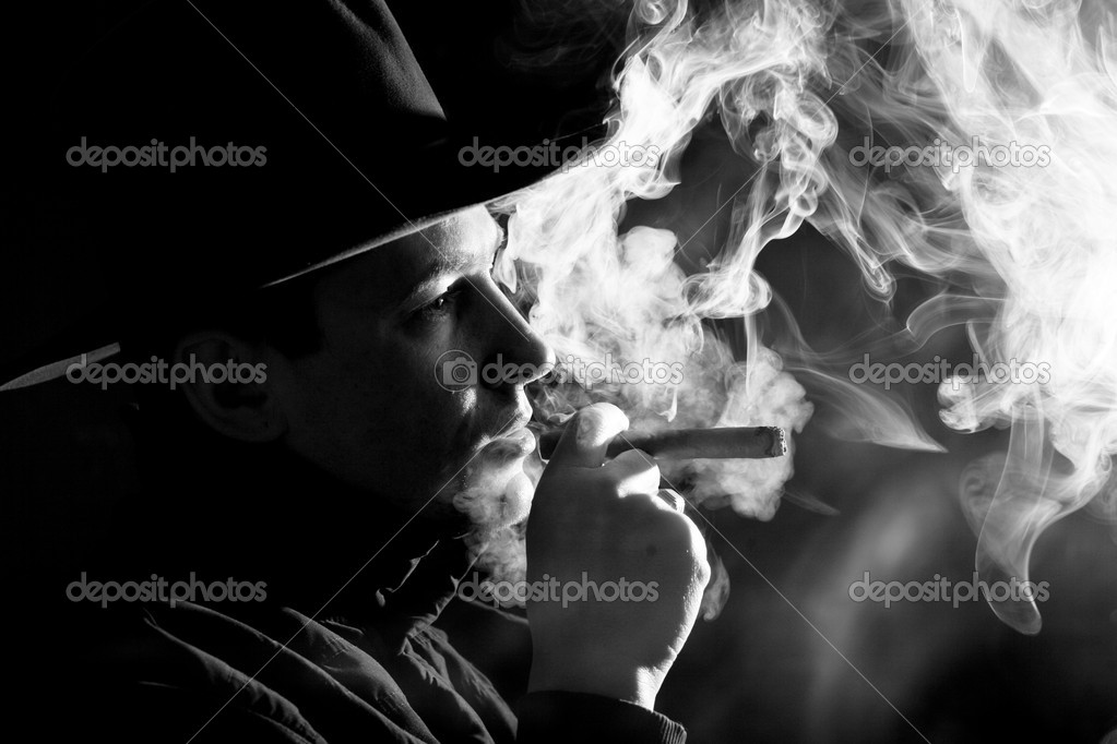 Black and white images of a man in clubs of smoke — Stock Photo #8581786