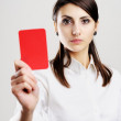 Woman showing red card — Stock Photo