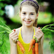 Stock Photo: Girl with carrots