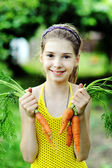 Girl with carrots — Stock Photo