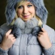 Girl in grey fur hat — Stock Photo