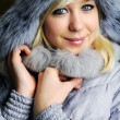Girl in grey fur hat — Stock Photo #8628811