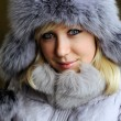Girl in grey fur hat — Stock Photo #8628812
