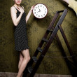 Woman with clock — Stock Photo #8629288