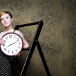 Stock Photo: Woman with clock