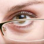Eye in glasses — Stock Photo #8629350