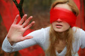 An image of woman with red blindfold — Stock Photo