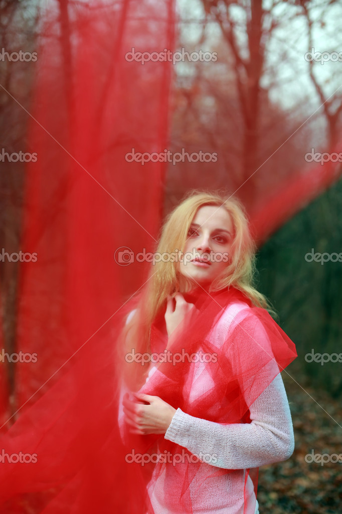 A beautiful young woman with a red shawl — Stock Photo #8629213
