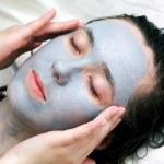 Woman putting a mask — Stock Photo #8633157