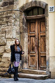 Woman at old door — Stock Photo