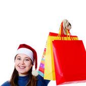 Menina sorridente com sacos — Fotografia Stock