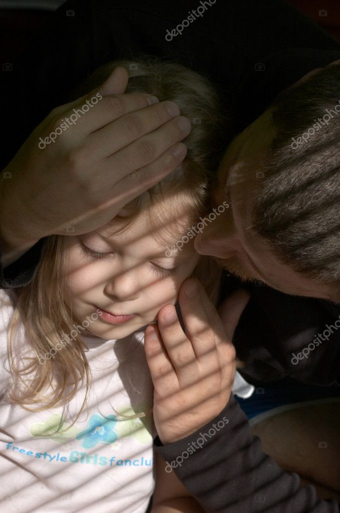 An image of father kissing his daughter  Stock Photo #8637940