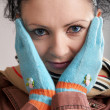 A girl in blue gloves - Stock Photo