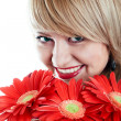 Portrait of woman with red flowers — Stock Photo