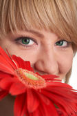 Girl with red flowers — Stock Photo