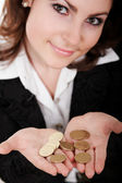 Girl with coins — Stock Photo