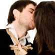 Kissing couple with rope — Stock Photo