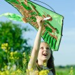 Royalty-Free Stock Photo: Girl plays kite