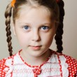 Stock Photo: Little girl in red