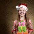 Girl with presents — Stock Photo #8659599