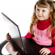 Girl with laptop in chair — Stock Photo