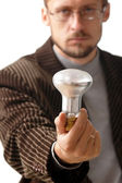 Lamp in hand — Stock Photo