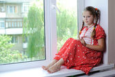 Little girl in red — Stock Photo