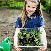 Girl with seedlings — Stock Photo