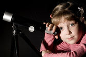 Girl and telescope — Stock Photo