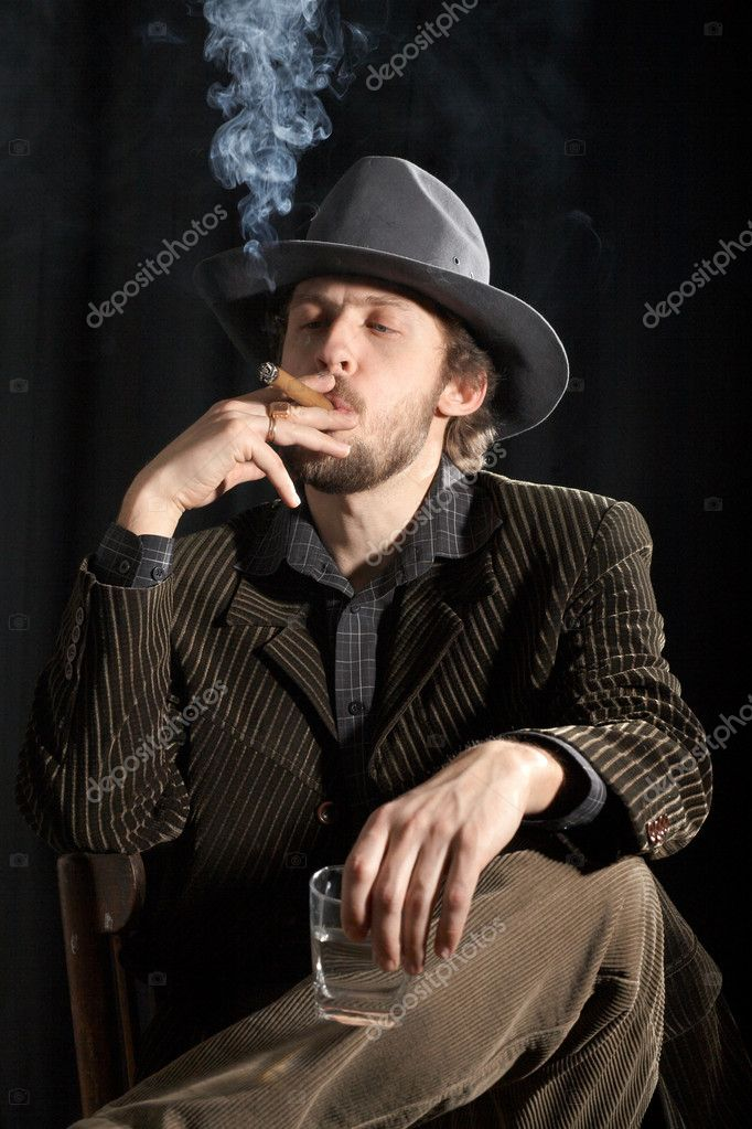 An image of a smoking man with cigar and glass — Stock Photo #8657309