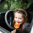 Girl in car — Stockfoto