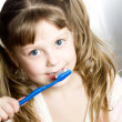 Girl with toothbrush — Stockfoto