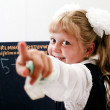 Little girl near chalkboard — Stock Photo #8660587