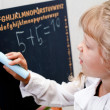 Little girl near blackboard — Foto Stock