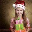Stock Photo: Girl with presents