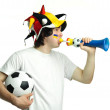 Football fan with ball and trumpet - Stock Photo