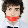 Tape on his mouth — Stock Photo #8662976
