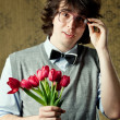 Stock Photo: Student with flowers