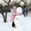 Girls with snowman — Stock Photo