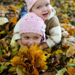 Sisters in yellow park — Stock Photo