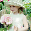 Girl in a greenhouse — Stock Photo #8664905