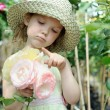 Girl in a greenhouse — Stock Photo