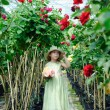 Girl in a greenhouse — Stock Photo #8664911