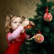 Decorating a tree - Stock Photo
