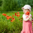 Baby-girl with poppies — Stock Photo