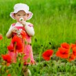 Child with red flower — Stock Photo