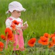 Baby with poppies — Stockfoto